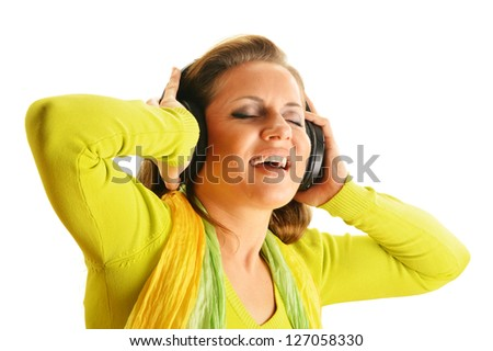 Happy young woman listening to the music in headphones isolated on white background