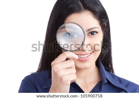 Happy young woman looking through magnifying glass isolated on white background. - stock photo