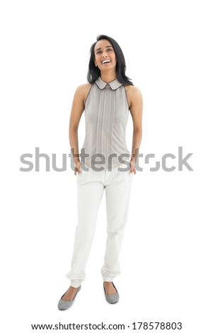 Happy young woman looking up over white background