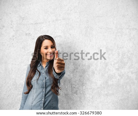 happy young woman okay sign - stock photo