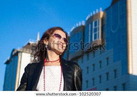 Happy young woman on a city street