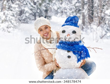 Happy young woman on a winter walk in nature. - stock photo