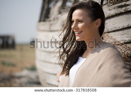 Happy Young Woman On Beach - stock photo