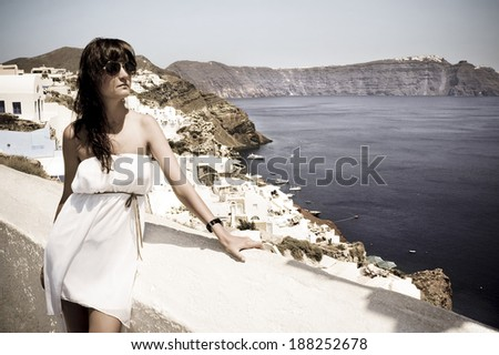 Happy young woman on Santorini Thira town. Photo in vintage style - stock photo