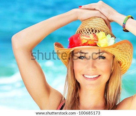Happy young woman on the beach, beautiful female face outdoor portrait, pretty healthy girl relaxing outside, nature fun and joy, spa and travel concept