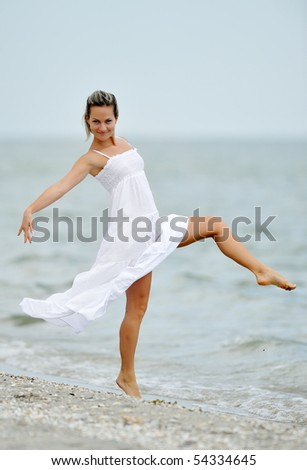 happy young woman on the beach in summer