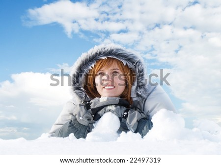 happy young woman on the snow