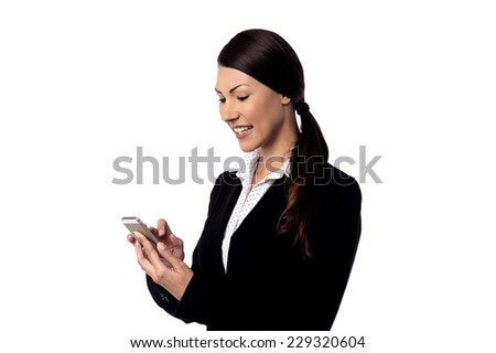 Happy young woman operating her cell phone - stock photo