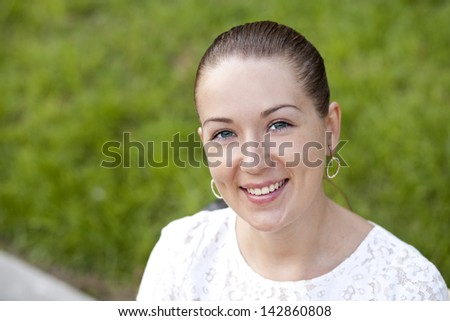 Happy young woman. Outdoor portrait