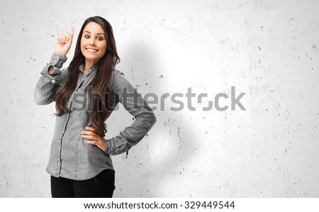 happy young woman pointing up - stock photo