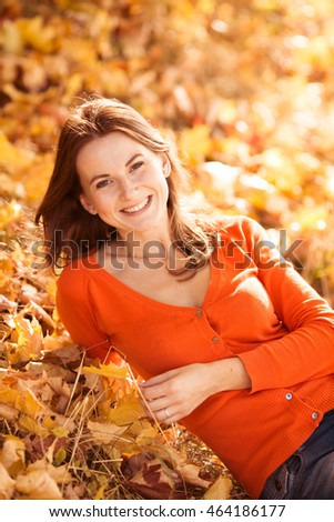 happy young woman posing in autumn forest