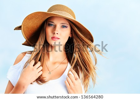 Happy young woman posing outdoor over blue sky. - stock photo