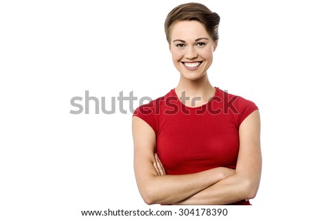 Happy young woman posing with folded arms - stock photo