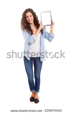 Happy young woman presenting your product in a tablet computer