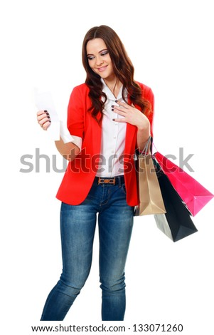 happy young woman reading receipt after good shopping - stock photo