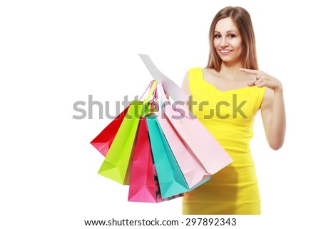 happy young woman reading receipt after good shopping