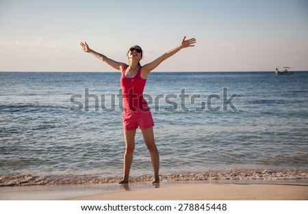 Happy young woman rejoices at summer vacation - stock photo
