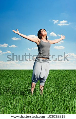 happy young woman relaxing at the field - stock photo