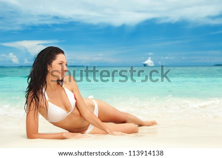 Happy young woman rest on the beach
