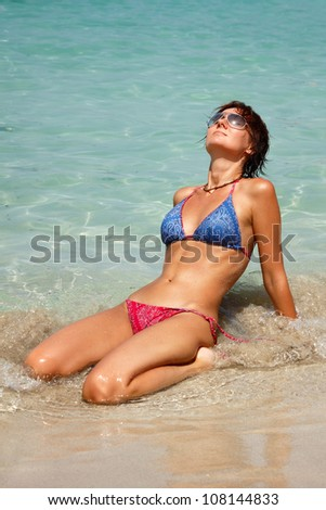 Happy young woman rest on the tropical beach