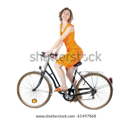happy young woman riding bicycle isolated on white background - stock photo