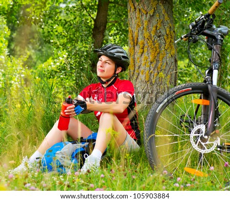 Happy Young Woman riding bicycle outside. Healthy Lifestyle. - stock photo