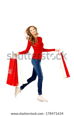Happy young woman  running with a lot of shopping bags. Sale. Isolated over white. - stock photo