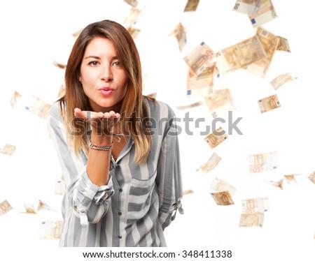 happy young woman sending kiss - stock photo