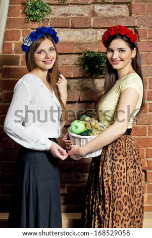 Happy young woman shopping in market for fruits - stock photo