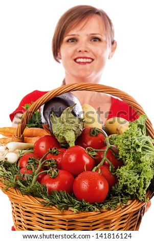 Happy  young woman showing a basket with fresh vegetables, closeup, isolated on white background