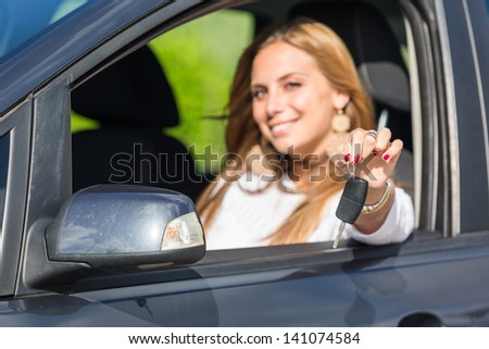 Happy Young Woman Showing Car Key - stock photo