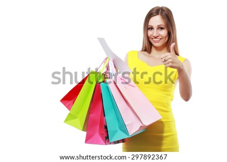 happy young woman showing receipt after good shopping hold thumb up
