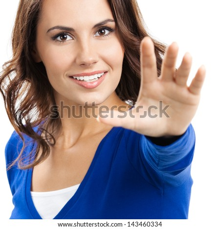 Happy young woman showing stop gesture, isolated over white background