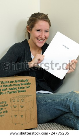 Happy young woman sitting holding mortgage