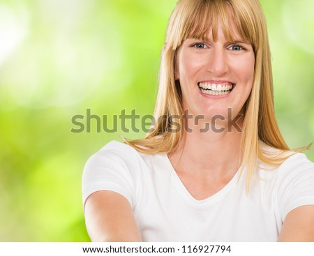 Happy Young Woman smiling against a nature background