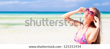 Happy young woman smiling in pink sunglassses on philippines beach