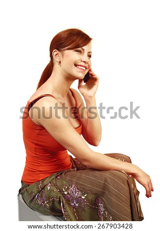 happy young woman speaks by mobile phone on white background - stock photo