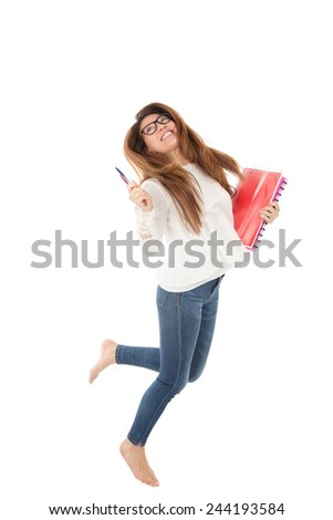 Happy young woman student jumping in the air against a white background - stock photo