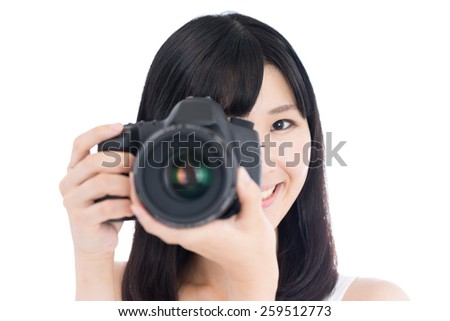happy young woman taking photo with digital single-lens reflex camera, isolated on white background