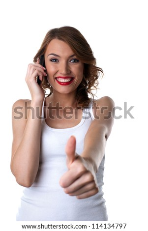 Happy Young woman talk on cell phone and thumbs up