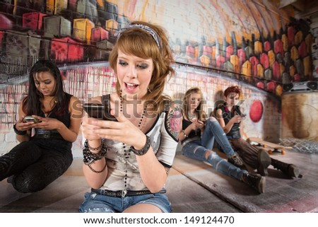 Happy young woman texting with cell phone - stock photo