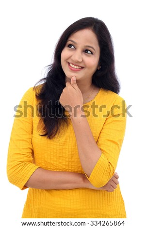Happy young woman thinking against white background - stock photo