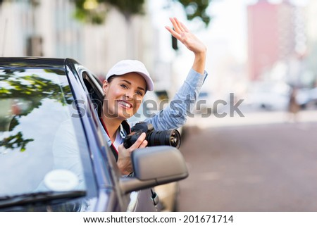 happy young woman touring in the city by car - stock photo