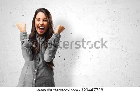 happy young woman victory sign - stock photo