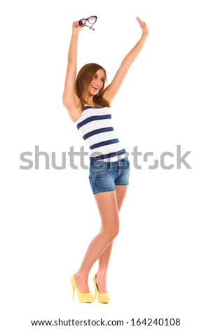 Happy young woman waving hands. Full length studio shot isolated on white. - stock photo
