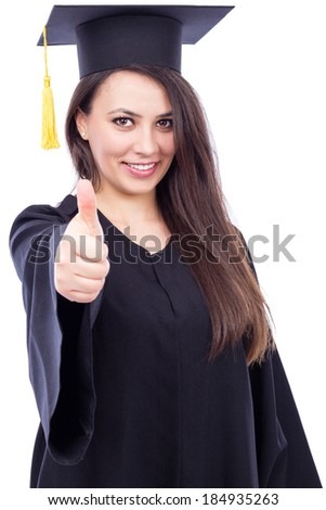 Happy young woman wearing cap and gown with thumb up isolated on  white background