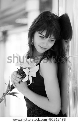 Happy young woman with a flowers - stock photo