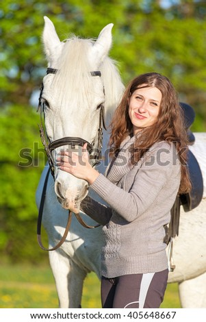 Happy young woman with a horse.