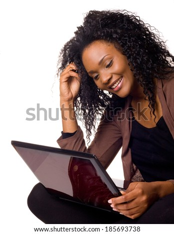 Happy young woman with a laptop computer isolated on a white background. - stock photo