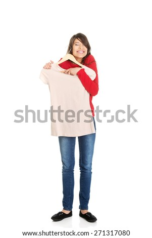 Happy young woman with a new shirt. - stock photo
